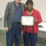 Ms. Betty Addison, pictured here with Mr. Robb, is presented the Top Volunteer Award.